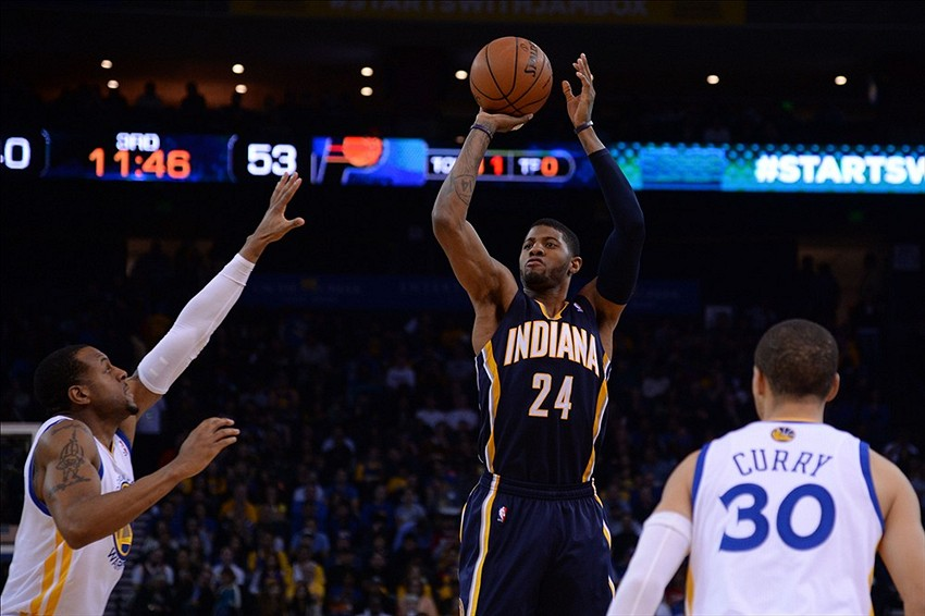 January 20, 2014; Oakland, CA, USA; Indiana Pacers small forward Paul George (24) shoots the ball against Golden State Warriors point guard Stephen Curry (30) during the third quarter at Oracle Arena. The Pacers defeated the Warriors 102-94. Mandatory Credit: Kyle Terada-USA TODAY Sports