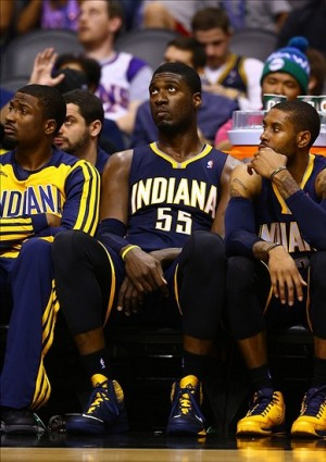 Jan 22, 2014; Phoenix, AZ, USA; Indiana Pacers center Roy Hibbert (center) sits on the bench after fouling out in the fourth quarter against the Phoenix Suns at US Airways Center. The Suns defeated the Pacers 124-100. Mandatory Credit: Mark J. Rebilas-USA TODAY Sports