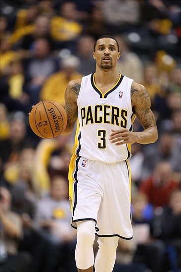 Feb 7, 2014; Indianapolis, IN, USA; Indiana Pacers guard George Hill (3) brings the ball up court against the Portland Trail Blazers at Bankers Life Fieldhouse. Indiana defeats Portland 118-113 in overtime. Mandatory Credit: Brian Spurlock-USA TODAY Sports