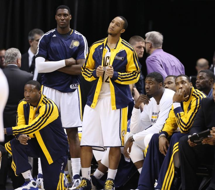 Apr 28, 2014; Indianapolis, IN, USA; Indiana Pacers bench (left to right) Donald Sloan, Ian Mahinmi, Evan Turner, Roy Hibbert, and Rasual Butler look on as they lose to the Atlanta Hawks in game five of the first round of the 2014 NBA Playoffs at Bankers Life Fieldhouse. Atlanta defeats Indiana 107-97. Mandatory Credit: Brian Spurlock-USA TODAY Sports