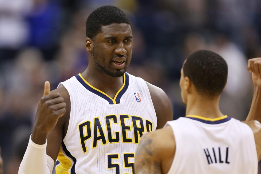 Dec 13, 2013; Indianapolis, IN, USA; Indiana Pacers center Roy Hibbert (55) talks to guard George HIll (3) during a game against the Charlotte Bobcats at Bankers Life Fieldhouse. Mandatory Credit: Brian Spurlock-USA TODAY Sports