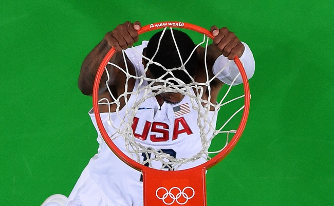 9477564-manu-ginobili-paul-george-olympics-basketball-men