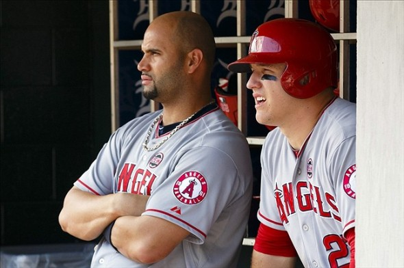 Los Angeles Angels designated hitter Albert Pujols (5) and center fielder Mike Trout (right) watches from the dugout in the second inning against the Detroit Tigers at Comerica Park. Mandatory Credit: Rick Osentoski-USA TODAY Sports