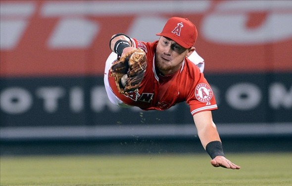 Anaheim, CA, USA; Los Angeles Angels right fielder Kole Calhoun (56) makes a diving catch for an out off a ball hit by Texas Rangers second baseman Ian Kinsler (5) in the fourth inning of the game at Angel Stadium. Mandatory Credit: Jayne Kamin-Oncea-USA TODAY Sports