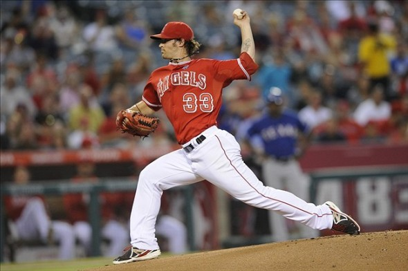 Sep 6, 2013; Anaheim, CA, USA; Los Angeles Angels pitcher C.J. Wilson (33) pitches against the Texas Rangers during the first inning at Angel Stadium of Anaheim. Mandatory Credit: Kelvin Kuo-USA TODAY Sports