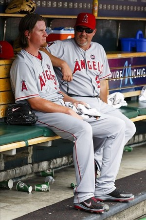 June 27, 2013; Detroit, MI, USA; Los Angeles Angels pitching coach Mike Butcher (23) talks to starting pitcher Jered Weaver (36) in the dugout in the fifth inning against the Detroit Tigers at Comerica Park. Mandatory Credit: Rick Osentoski-USA TODAY Sports