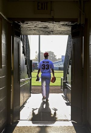 Feb 26, 2014; Tempe, AZ, USA; Los Angeles Angels pitcher C.J. Wilson heads to the field after participating in photo day at Tempe Diablo Stadium. Mandatory Credit: Justin Tooley-USA TODAY Sports
