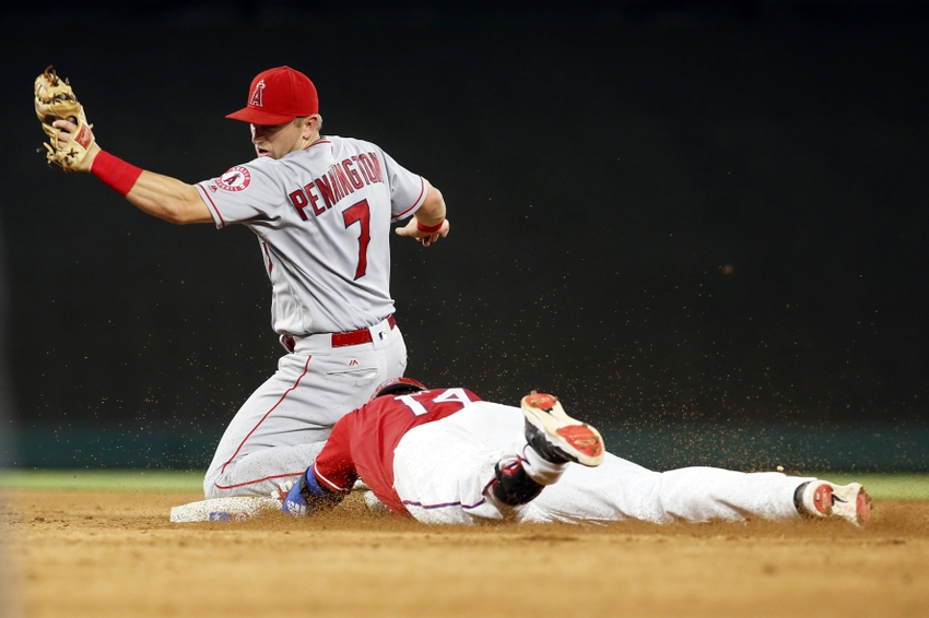 9554550-carlos-gomez-cliff-pennington-mlb-los-angeles-angels-texas-rangers