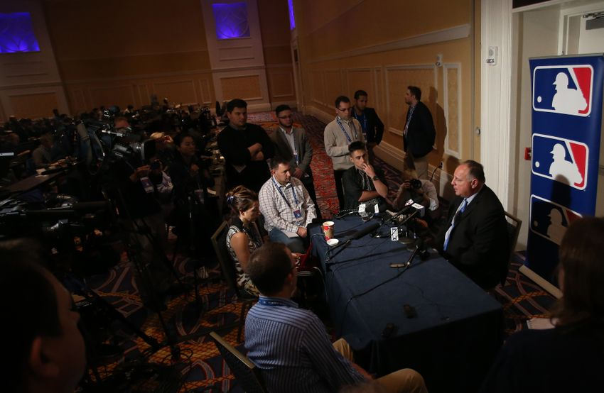 9730043-mike-scioscia-mlb-winter-meetings