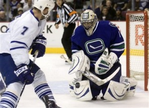 Roberto Luongo stops Ian White in one of 35 saves Saturday versus the Maple Leafs - photo courtesy of Yahoo! Sports