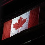 Feb 14, 2012; Winnipeg, MB, CANADA; General view of the Canadian flag during the singing of the National anthem prior to the game between the Winnipeg Jets and the New York Islanders at MTS Center. Mandatory Credit: Bruce Fedyck-US PRESSWIRE