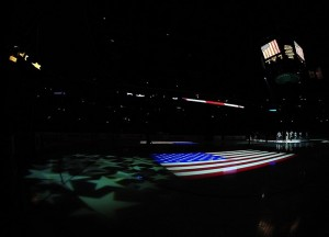 Mar. 30, 2012; Columbus, OH, USA; An American flag is projected onto the ice during the signing of the national anthem prior to the game between the Florida Panthers and Columbus Blue Jackets at Nationwide Arena. Mandatory Credit: Andrew Weber-US PRESSWIRE