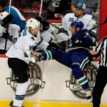 Sep 16, 2013; Vancouver, British Columbia, CAN; San Jose Sharks forward James Sheppard (15) checks Vancouver Canucks defenseman Yannick Weber (6) into the boards during the first period at Rogers Arena. Mandatory Credit: Anne-Marie Sorvin-USA TODAY Sports