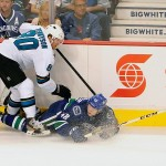 Sep 16, 2013; Vancouver, British Columbia, CAN; San Jose Sharks defenseman Matt Tennyson (80) checks Vancouver Canucks forward Hunter Shinkaruk (48) during the first period at Rogers Arena. Mandatory Credit: Anne-Marie Sorvin-USA TODAY Sports