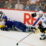 Sep 16, 2013; Vancouver, British Columbia, CAN; Vancouver Canucks defenseman Frank Corrado (26) is checked by San Jose Sharks forward Matt Pelech (42) during the first period at Rogers Arena. Mandatory Credit: Anne-Marie Sorvin-USA TODAY Sports