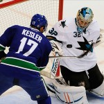 Sep 16, 2013; Vancouver, British Columbia, CAN; Vancouver Canucks forward Ryan Kesler (17) has a scoring chance against San Jose Sharks goaltender Alex Stalock (32) during the first period at Rogers Arena. Mandatory Credit: Anne-Marie Sorvin-USA TODAY Sports