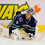 Sep 16, 2013; Vancouver, British Columbia, CAN; Vancouver Canucks goaltender Eddie Lack (31) during stretches before the game against the San Jose Sharks at Rogers Arena. Mandatory Credit: Anne-Marie Sorvin-USA TODAY Sports
