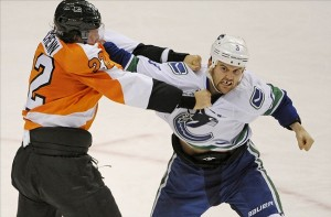 Oct 15, 2013; Philadelphia, PA, USA; Philadelphia Flyers defenseman Luke Schenn (22) fights against Vancouver Canucks right wing Zack Kassian (9) during the first period at Wells Fargo Center. Mandatory Credit: Eric Hartline-USA TODAY Sports