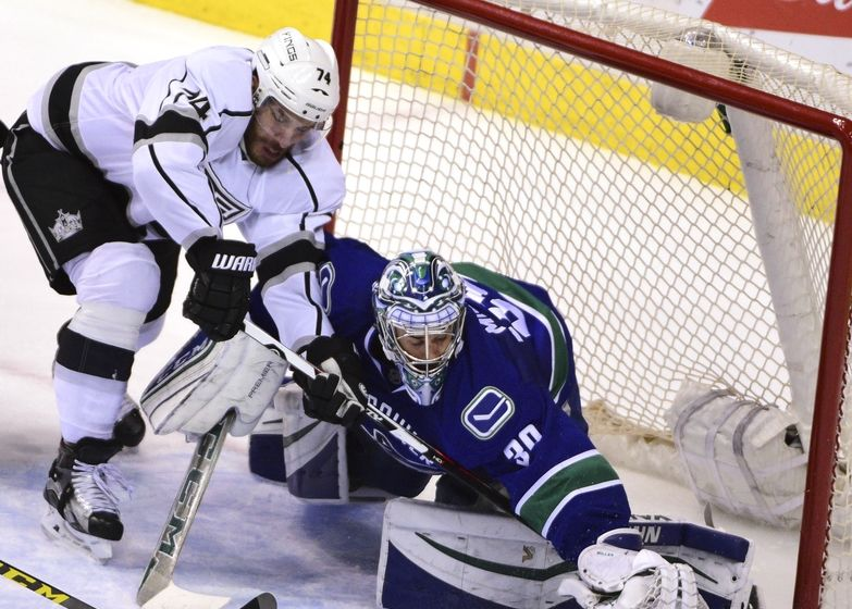 Apr 4, 2016; Vancouver, British Columbia, CAN; Vancouver Canucks goaltender Ryan Miller (30) defends against Los Angeles Kings forward <a rel=