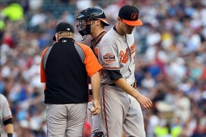 July 16, 2012; Baltimore Orioles pitcher Chris Tillman (30) is removed from the game by manager Buck Showalter (26) during the first inning against the Minnesota Twins ... Credit: Brace Hemmelgarn-US PRESSWIRE