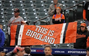 Oct 7, 2012; Baltimore, MD, USA; Baltimore Orioles fans show their support for the team prior to game one of the 2012 ALDS at Oriole Park at Camden Yards. Mandatory Credit: