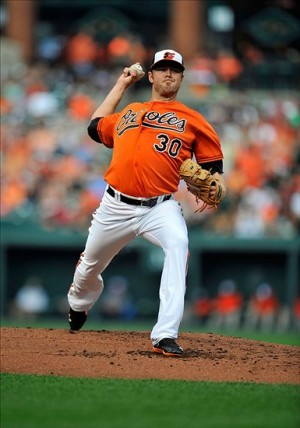 Aug 24, 2013; Baltimore, MD, USA; Baltimore Orioles pitcher Chris Tillman (30) throws in the second inning against the Oakland Athletics at Oriole Park at Camden Yards. Mandatory Credit: