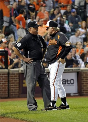 Sep 9, 2013; Baltimore, MD, USA; Baltimore Orioles manager Buck Showalter (26) argues with umpire crew chief Jim Joyce after the first inning during a game against the New York Yankees at Oriole Park at Camden Yards. Mandatory Credit: Joy R. Absalon-USA TODAY Sports