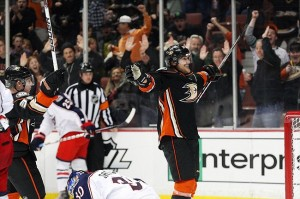 Feb 3, 2012; Anaheim, CA, USA; Anaheim Ducks right wing Teemu Selanne (center) celebrates after scoring a goal during the second period against the Columbus Blue Jackets at the Honda Center. Mandatory Credit: Jake Roth-US PRESSWIRE