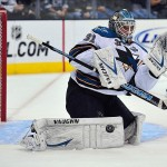 March 16, 2013; Los Angeles, CA, USA; San Jose Sharks goalie Antti Niemi (31) blocks a shot against the Los Angeles Kings during the first period at Staples Center. Mandatory Credit: Gary A. Vasquez-USA TODAY Sports