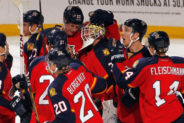 SUNRISE, FL - NOVEMBER 12: Goaltender Tim Thomas #34 of the Florida Panthers celebrates their 3-2 win with teammates against the Anaheim Ducks at the BB&T Center on November 12, 2013 in Sunrise, Florida. (Photo by Eliot J. Schechter/NHLI via Getty Images)