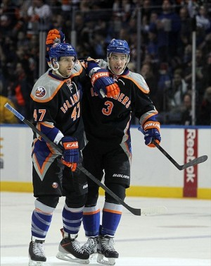 Mar 24, 2013; Uniondale, NY, USA; New York Islanders defenseman Andrew MacDonald (47) and New York Islanders defenseman Travis Hamonic (3) celebrate MacDonald