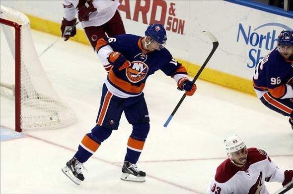Oct 8, 2013; Uniondale, NY, USA; New York Islanders center Peter Regin (16) reacts after scoring a goal against the Phoenix Coyotes during the first period of a game at Nassau Veterans Memorial Coliseum. Mandatory Credit: Brad Penner-USA TODAY Sports