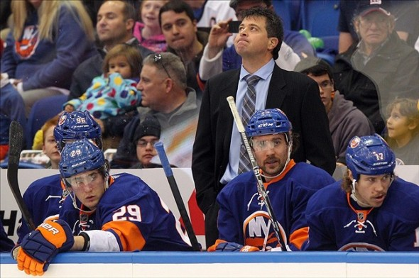 Nov 29, 2013; Uniondale, NY, USA; New York Islanders head coach Jack Capuano reacts during the first period of a game against the Detroit Red Wings at Nassau Veterans Memorial Coliseum. Mandatory Credit: Brad Penner-USA TODAY Sports