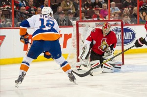 Sept 29, 2013; Ottawa, Ontario, CAN; New York Islanders centre Ryan Strome (18) shoots on Ottawa Senators goalie Craig Anderson (41) in the first period at the Canadian Tire Centre. Mandatory Credit: Marc DesRosiers-USA TODAY Sports