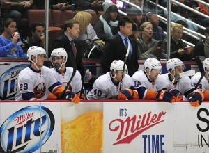 December 9, 2013; Anaheim, CA, USA; New York Islanders head coach Jack Capuano (blue shirt) watches game action against the Anaheim Ducks during the first period at Honda Center. Mandatory Credit: Gary A. Vasquez-USA TODAY Sports