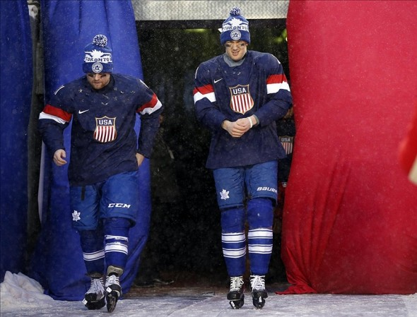 Jan 1, 2014; Ann Arbor, MI, USA; Toronto Maple Leafs players Phil Kessel (left) and James van Riemsdyk (right) are introduced as members of the U.S. Olympic hockey team after the 2014 Winter Classic hockey game against the Detroit Red Wings at Michigan Stadium. Mandatory Credit: Rick Osentoski-USA TODAY Sports