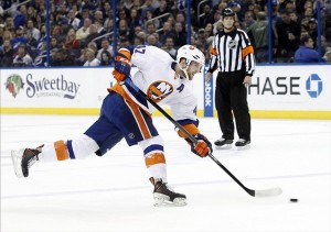 Jan 16, 2014; Tampa, FL, USA; New York Islanders defenseman Andrew MacDonald (47) shoots against the Tampa Bay Lightning during the first period at Tampa Bay Times Forum. Mandatory Credit: Kim Klement-USA TODAY Sports
