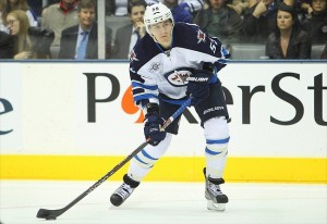 Oct 19, 2011; Winnipeg Jets center Mark Scheifele (55) with the puck against the Toronto Maple Leafs. Tom Szczerbowski-USA TODAY Sports