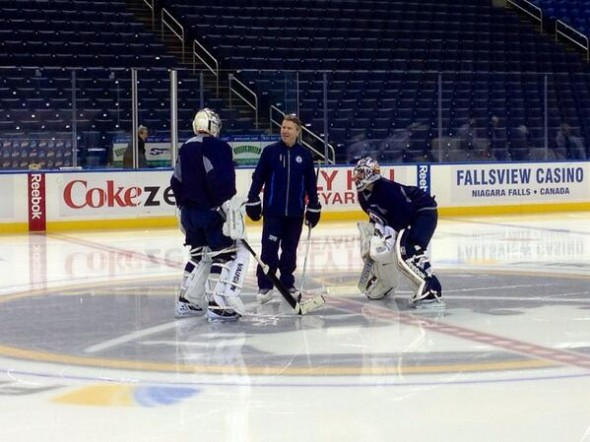 Coach Wade Flaherty chats with Pavelec and Montoya at centre ice in the First Niagara Center on Tuesday morning. Picture Courtesy: twitter.com/NHLJets