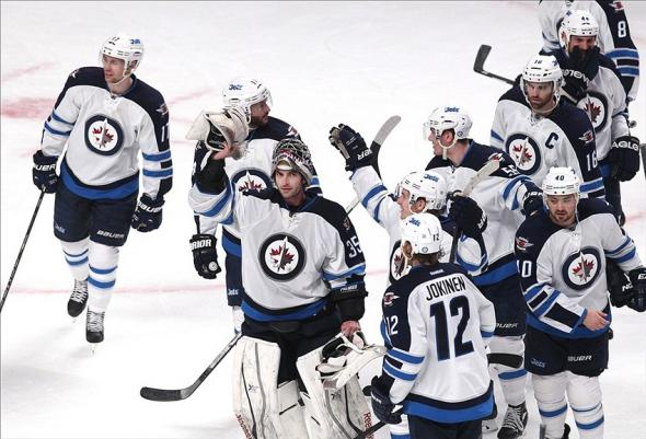 Feb 2, 2014; Montreal, Quebec, CAN; Winnipeg Jets goalie Al Montoya (35) waves to the crowd as he exists the ice with teammates after their win against Montreal Canadiens at Bell Centre. Mandatory Credit: Jean-Yves Ahern-USA TODAY Sports