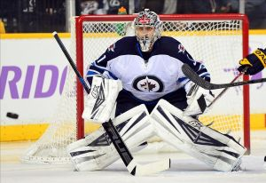 Mar 1, 2014; Nashville, TN, USA; Winnipeg Jets goalie Ondrej Pavelec (31) watches the puck during the hockey game against the Nashville Predators at Bridgestone Arena. Mandatory Credit: Don McPeak-USA TODAY Sports