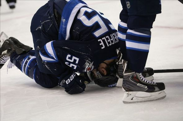 Mar 4, 2014; Winnipeg, Manitoba, CAN; Winnipeg Jets forward Mark Scheifele (55) is hurt during the second period against the New York Islanders at MTS Centre. Mandatory Credit: Bruce Fedyck-USA TODAY Sports