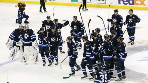 Apr 10, 2014; Winnipeg, Manitoba, CAN; Winnipeg Jets celebrate their victory after the shootout period against Boston Bruins at MTS Centre. Winnipeg wins 2-1 overtime. Mandatory Credit: Bruce Fedyck-USA TODAY Sports