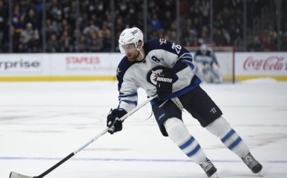 Apr 9, 2016; Los Angeles, CA, USA; Winnipeg Jets right wing Blake Wheeler (26) skates down the ice during a shootout against the Los Angeles Kings at Staples Center. The Winnipeg Jets won 4-3 in a shootout. Mandatory Credit: Kelvin Kuo-USA TODAY Sports