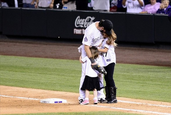 Helton's daughters join him at first base in the top of the 9th. Ron Chenoy-USA TODAY Sports