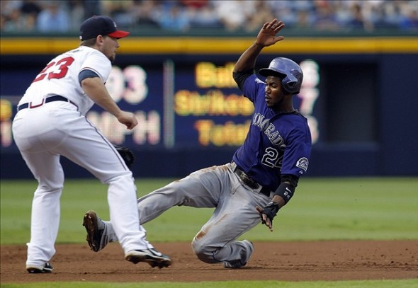 Jul 30, 2013; Atlanta, GA, USA; Colorado Rockies center fielder Dexter Fowler (24) slides safely into third base against the Atlanta Braves in the first inning at Turner Field. Mandatory Credit: Brett Davis-USA TODAY Sports