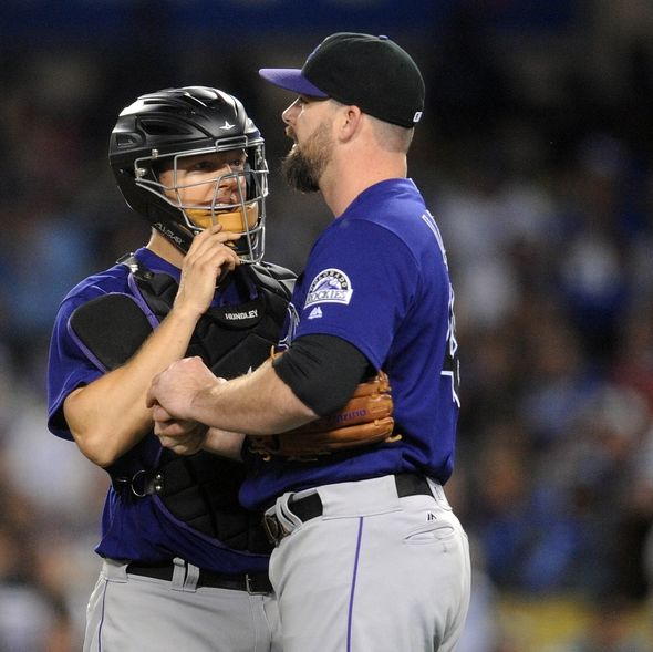 9558649-nick-hundley-boone-logan-mlb-colorado-rockies-los-angeles-dodgers-590x589