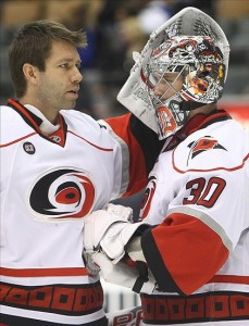 "Cam Ward enjoys a good Stew hug. Your coworkers may say ""no"". Mandatory Credit: Tom Szczerbowski-US PRESSWIRE"