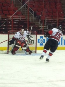 Tripp Tracy in net during warmups. Photo Credit: Jennifer Caslin