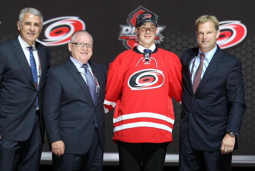Jun 30, 2013; Newark, NJ, USA; Elias Lindholm poses for a photo with team officials after being introduced as the number five overall pick to the Carolina Hurricanes during the 2013 NHL Draft at the Prudential Center. Mandatory Credit: Ed Mulholland-USA TODAY Sports